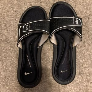Adidas slides with a cushion bottom.